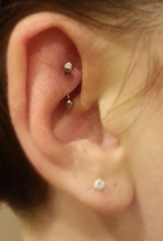 Rook Piercing Done With A 16 Gauge Curved Barbell Clear Gems